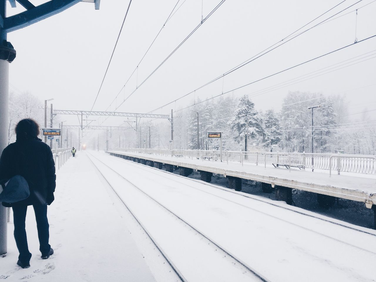 Adult Adults Only Architecture Built Structure City City Life Cold Temperature Day One Person Only Men Outdoors Overhead Cable Car People Real People Sky Snow Snowing Transportation Tree Weather Winter
