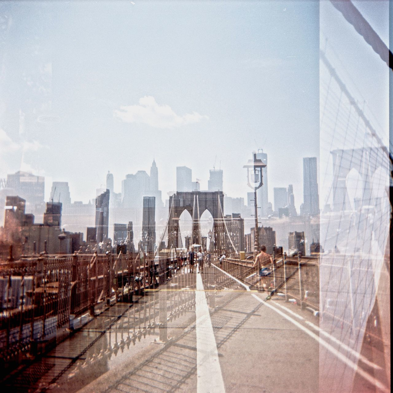 Multiple Exposure Of Brooklyn Bridge And Cityscape Against Sky