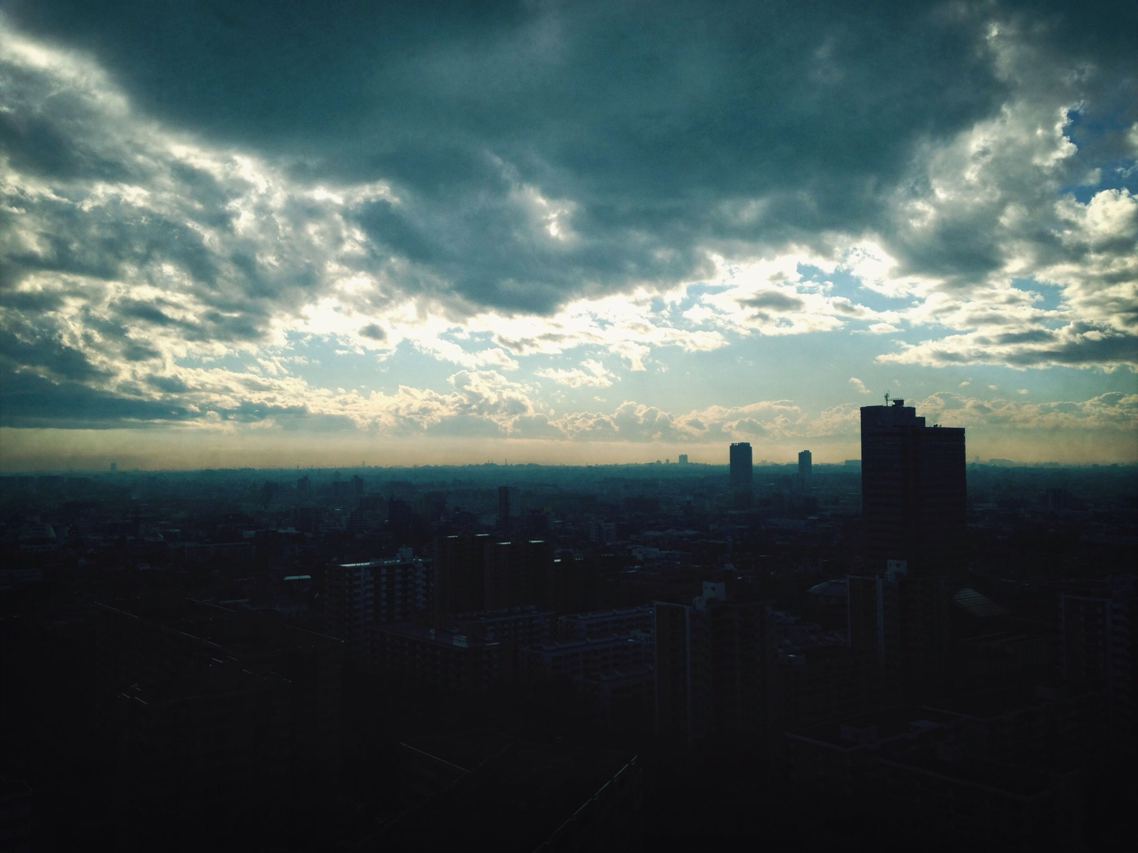 city, cityscape, building exterior, architecture, sky, built structure, cloud - sky, sunset, skyscraper, cloudy, crowded, cloud, high angle view, urban skyline, silhouette, modern, residential district, city life, dusk, tower