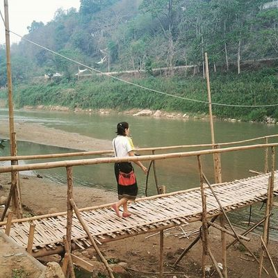Woman crossing a bamboo Bridge over the NamKhanRiver in Luangprabang Laos . Mekong Riverside Southeastasia Travel Travelshots Wanderlust Adventure Dailyphoto Photooftheday Peoplewatching