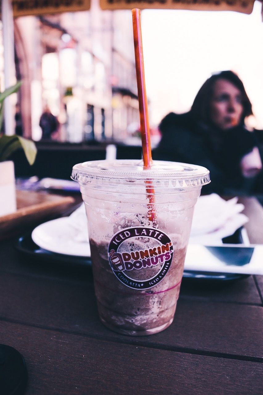 drink, drinking straw, drinking glass, refreshment, food and drink, table, focus on foreground, indoors, freshness, iced coffee, real people, one person, close-up, cold temperature, day, people
