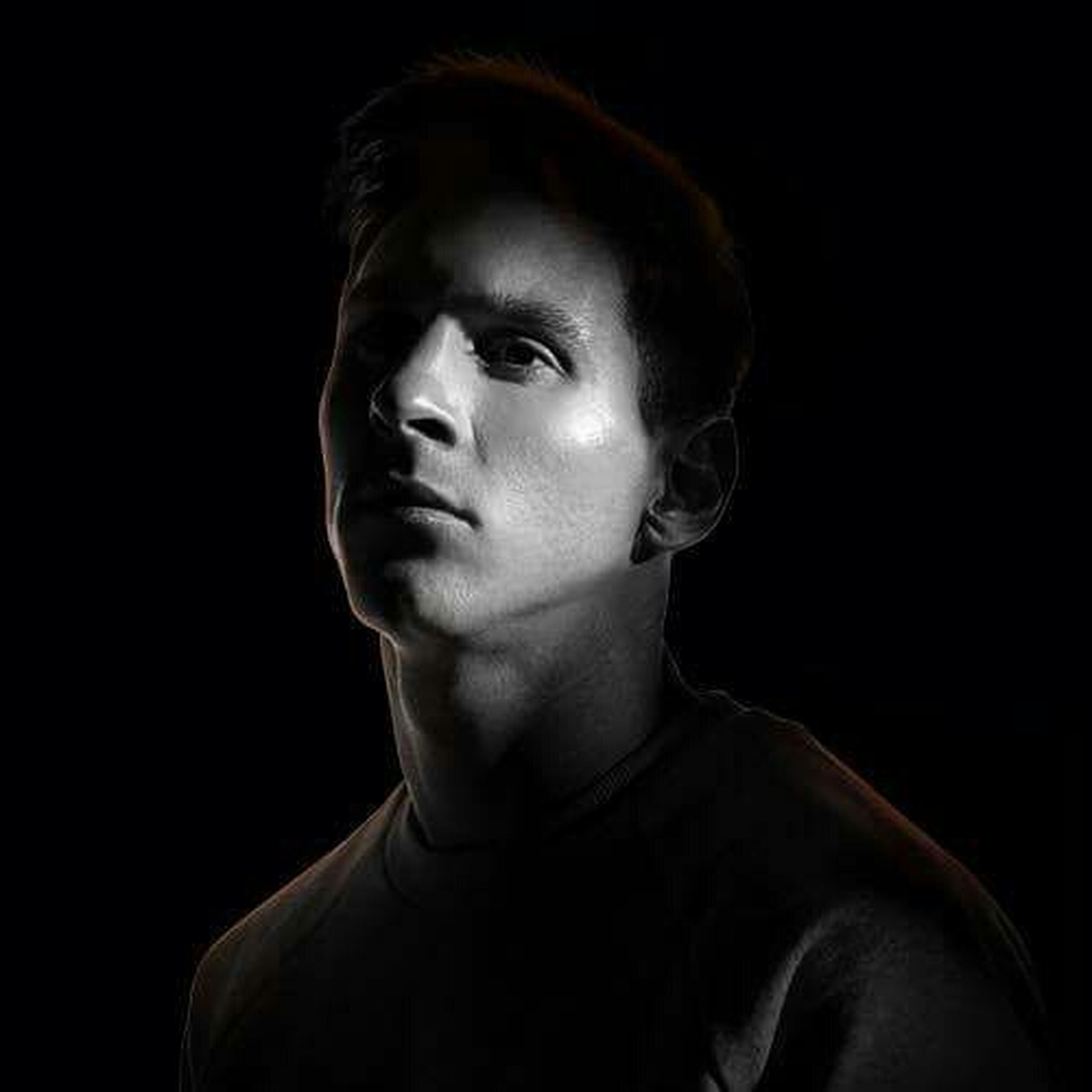 studio shot, black background, headshot, person, portrait, looking at camera, serious, young adult, front view, lifestyles, close-up, head and shoulders, human face, contemplation, copy space, indoors, young men