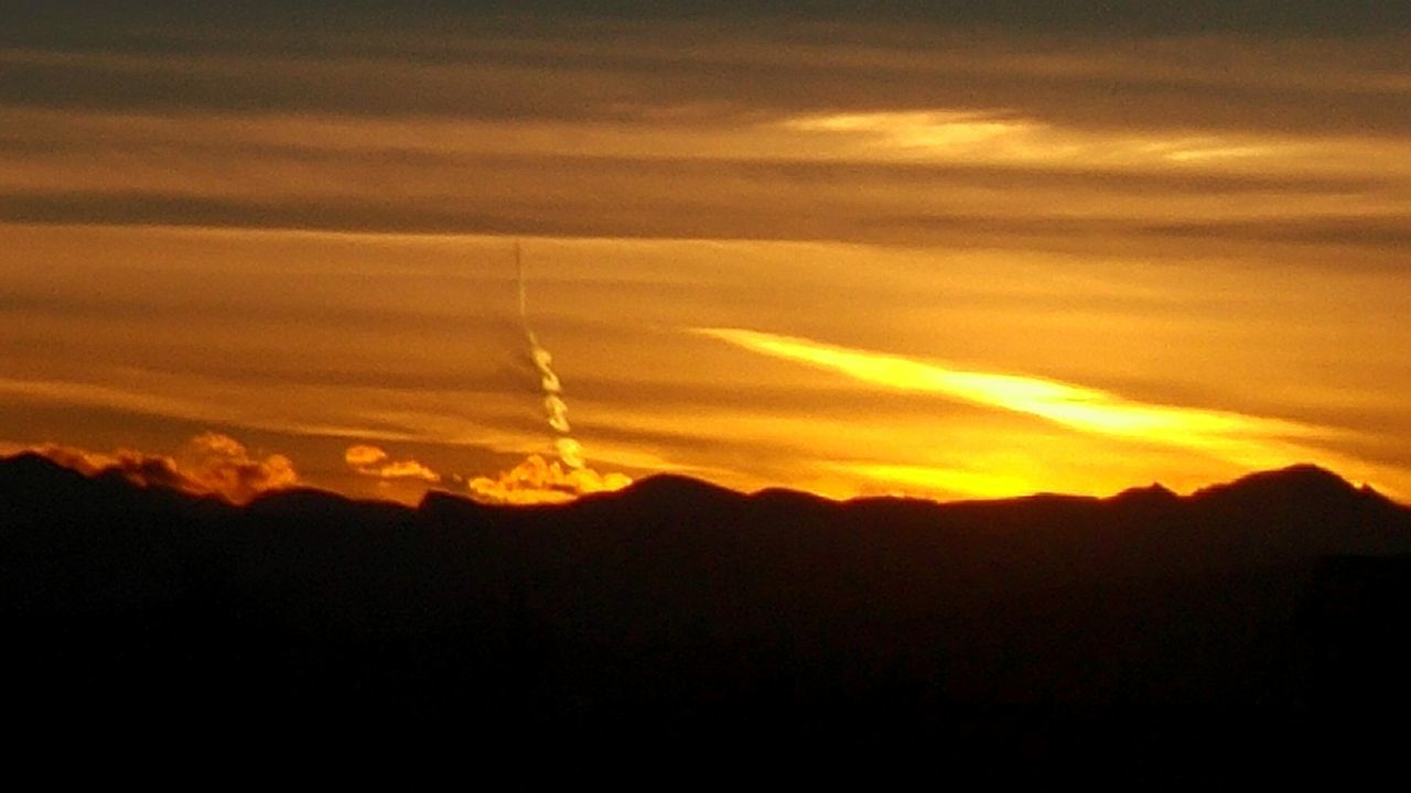 sunset, silhouette, beauty in nature, nature, scenics, sky, majestic, tranquility, tranquil scene, vapor trail, no people, contrail, landscape, mountain, outdoors