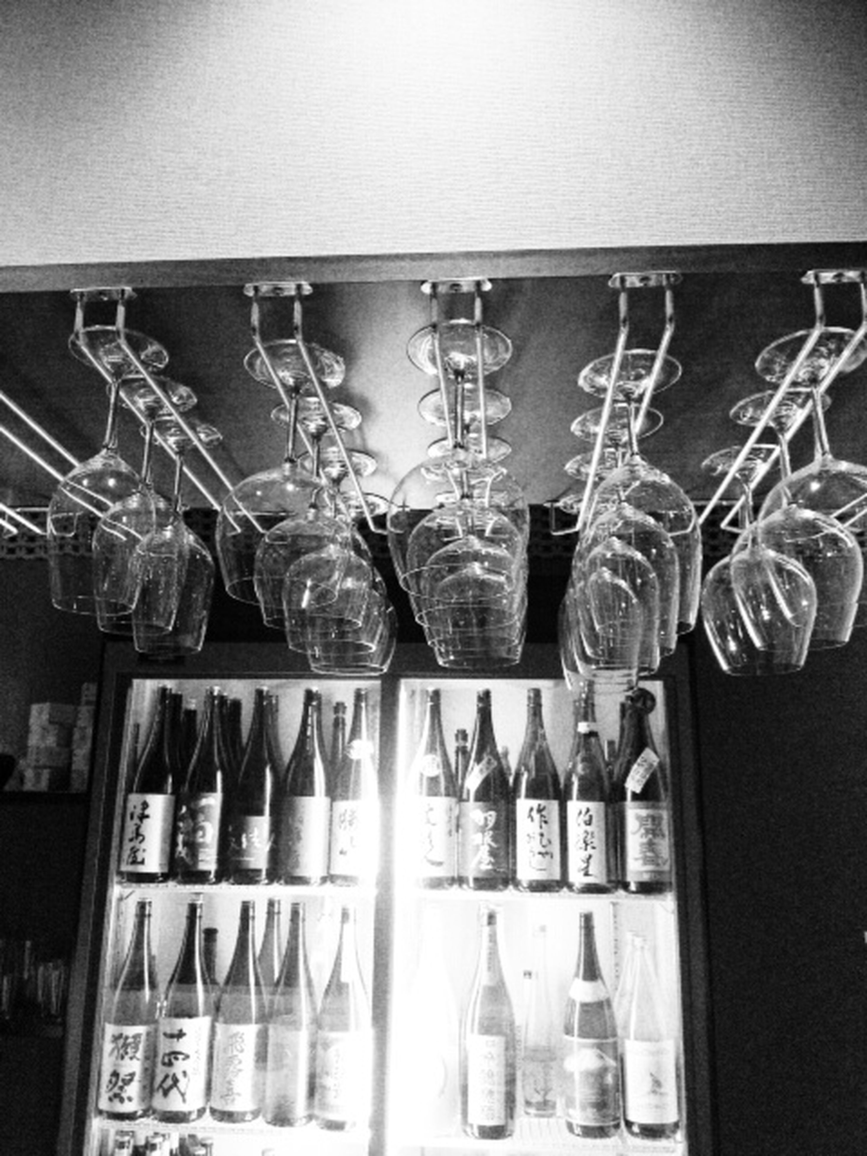 indoors, large group of objects, still life, hanging, variation, shelf, arrangement, in a row, glass - material, choice, abundance, order, close-up, bottle, reflection, side by side, metal, collection, transparent, retail