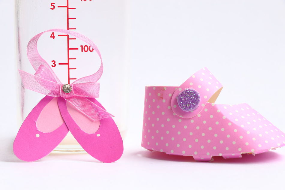 Baby bottle with a pink paper shoe. Arrangement Baby Baby Bottle Babygirl Beautiful Composition Creativity Delicate Detail Female Ideas Paper Picoftheday Pink Shoe Single Object White Background