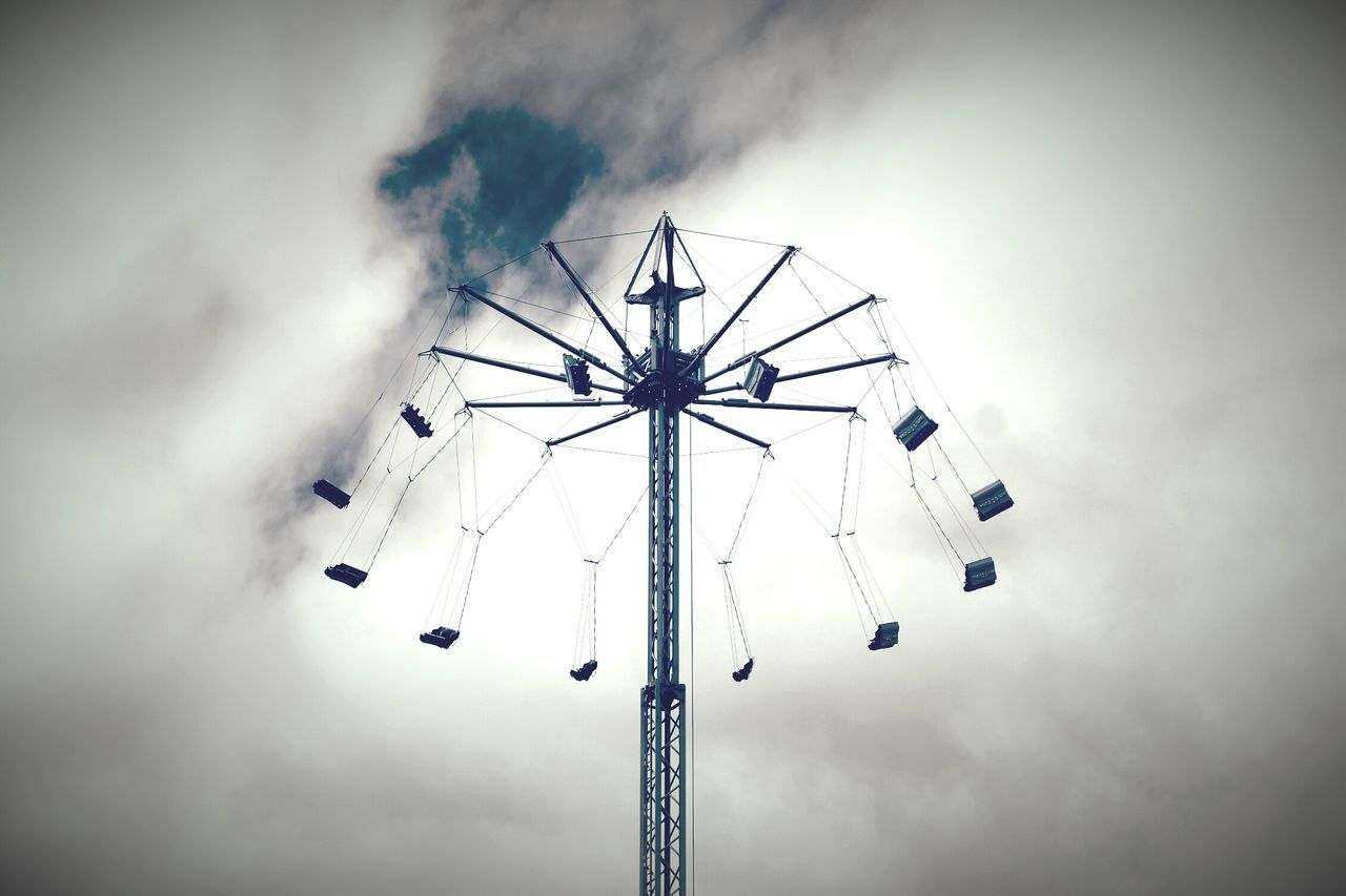 low angle view, amusement park, arts culture and entertainment, amusement park ride, sky, no people, day, outdoors, nature