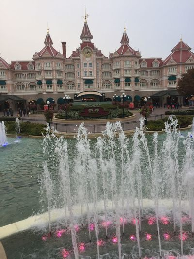 Disney Disneyland Paris DisneyMagic  Built Structure Building Exterior Architecture Water In Front Of Motion Travel Destinations Fountain City Spraying Flowing Famous Place Pediment Flowing Water National Landmark Waterfront Townhouse Outdoors City Life Tourism