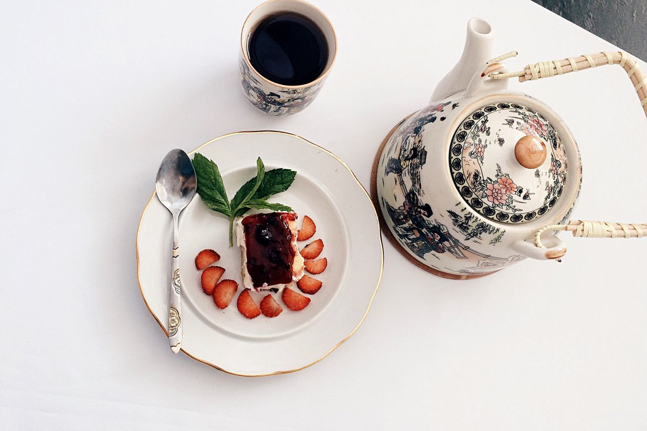 Teapot With Coffee And Cake Slice On Table