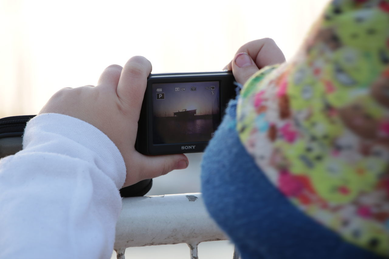 Camera Close-up Communication Day Digital Viewfinder Holding Human Body Part Human Hand Kid Kid Take Photos Men Only Men People Portable Information Device Smart Phone Technology Two People Wireless Technology