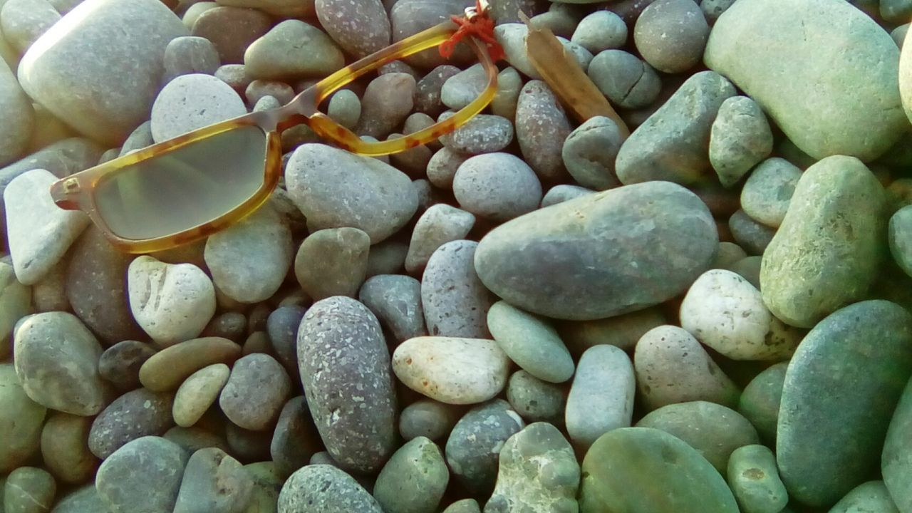 Backgrounds Beauty In Nature Broken Glasses Close-up Day Full Frame Nature No People Outdoors Pebble Pebble Beach