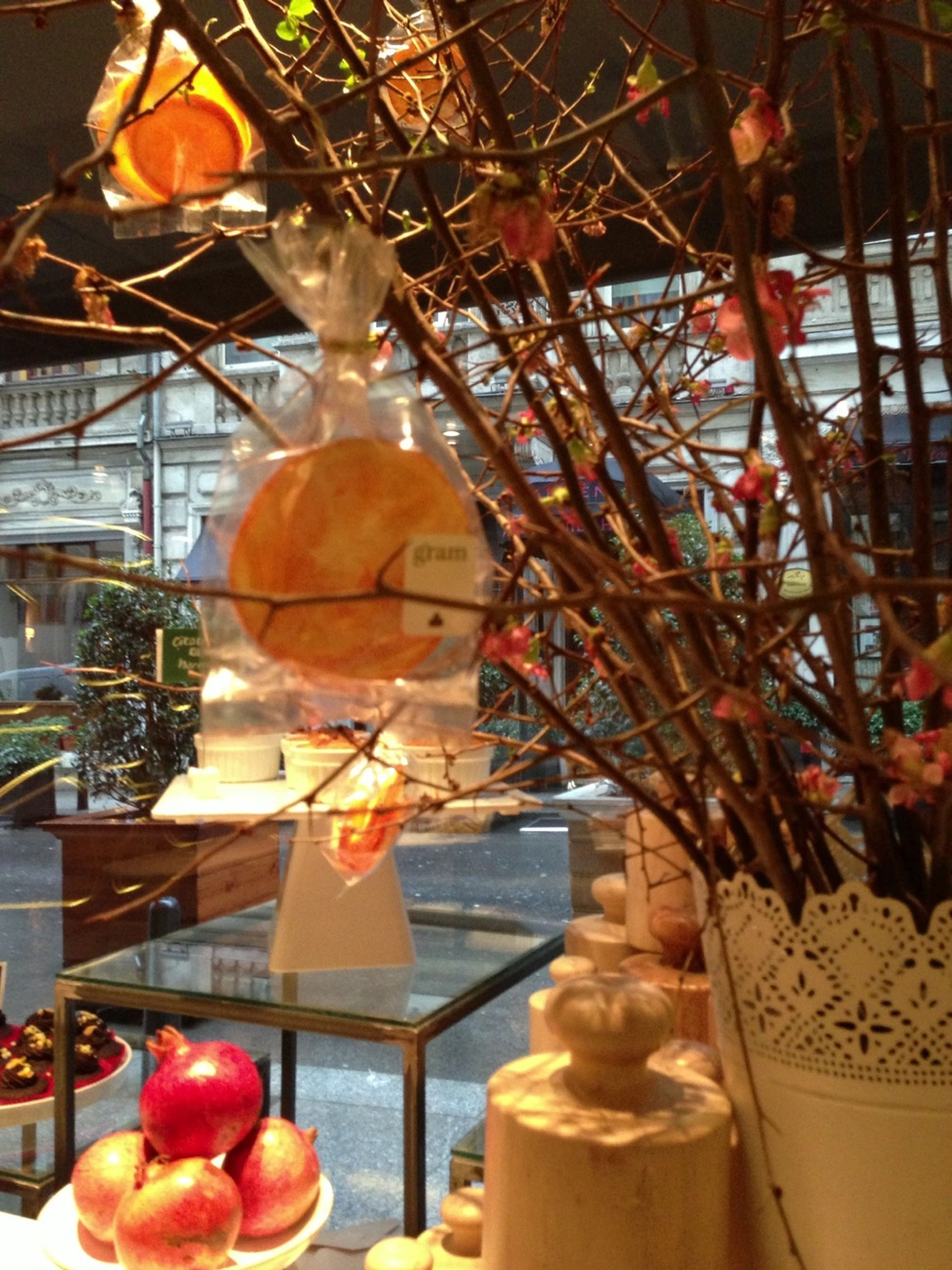 indoors, food and drink, hanging, food, decoration, still life, celebration, illuminated, freshness, retail, close-up, glass - material, low angle view, for sale, tradition, healthy eating, cultures, focus on foreground, lantern, restaurant