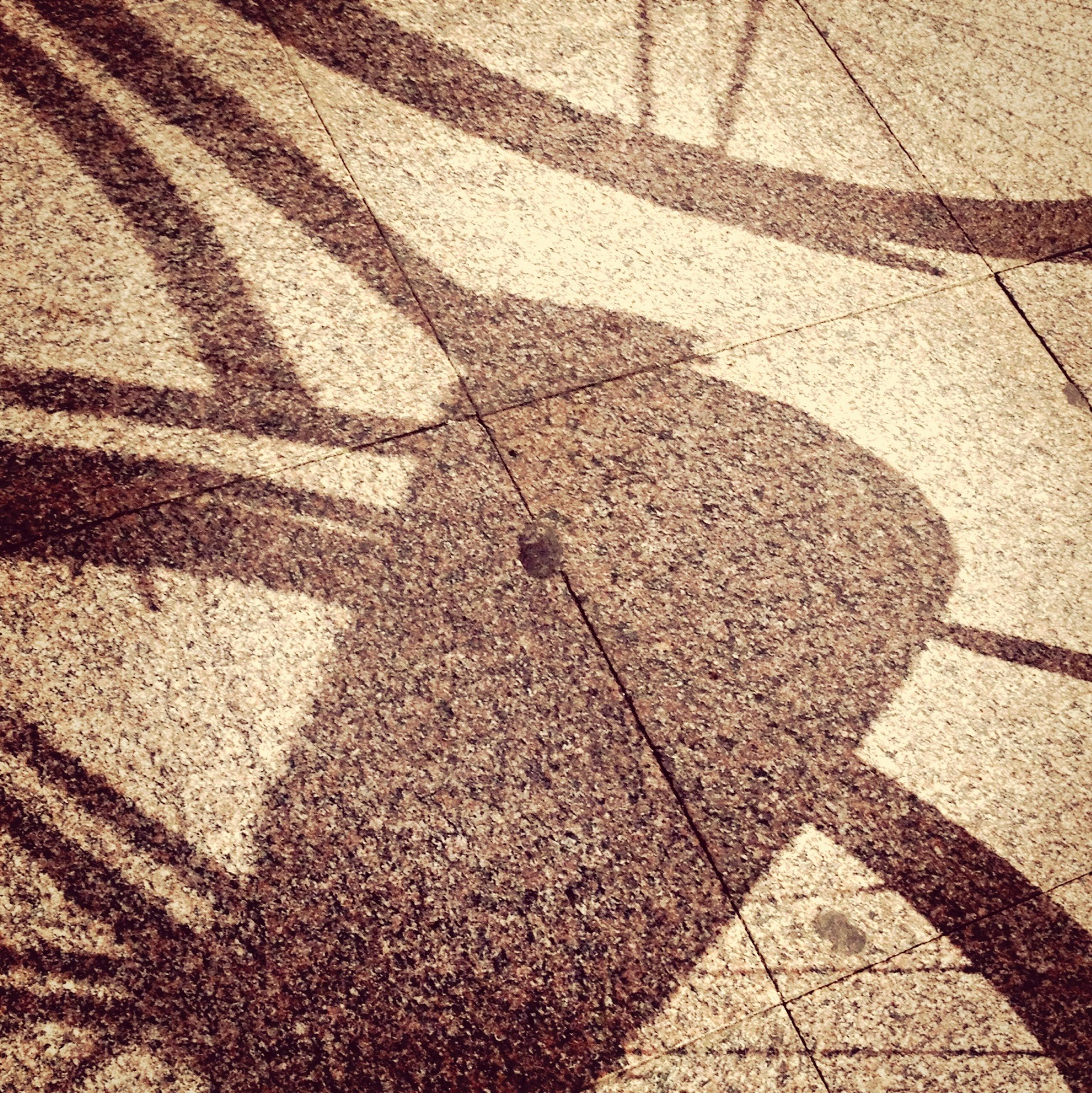 shadow, high angle view, pattern, full frame, sunlight, textured, backgrounds, cobblestone, street, focus on shadow, paving stone, footpath, day, outdoors, no people, sidewalk, road, sunny, asphalt, elevated view