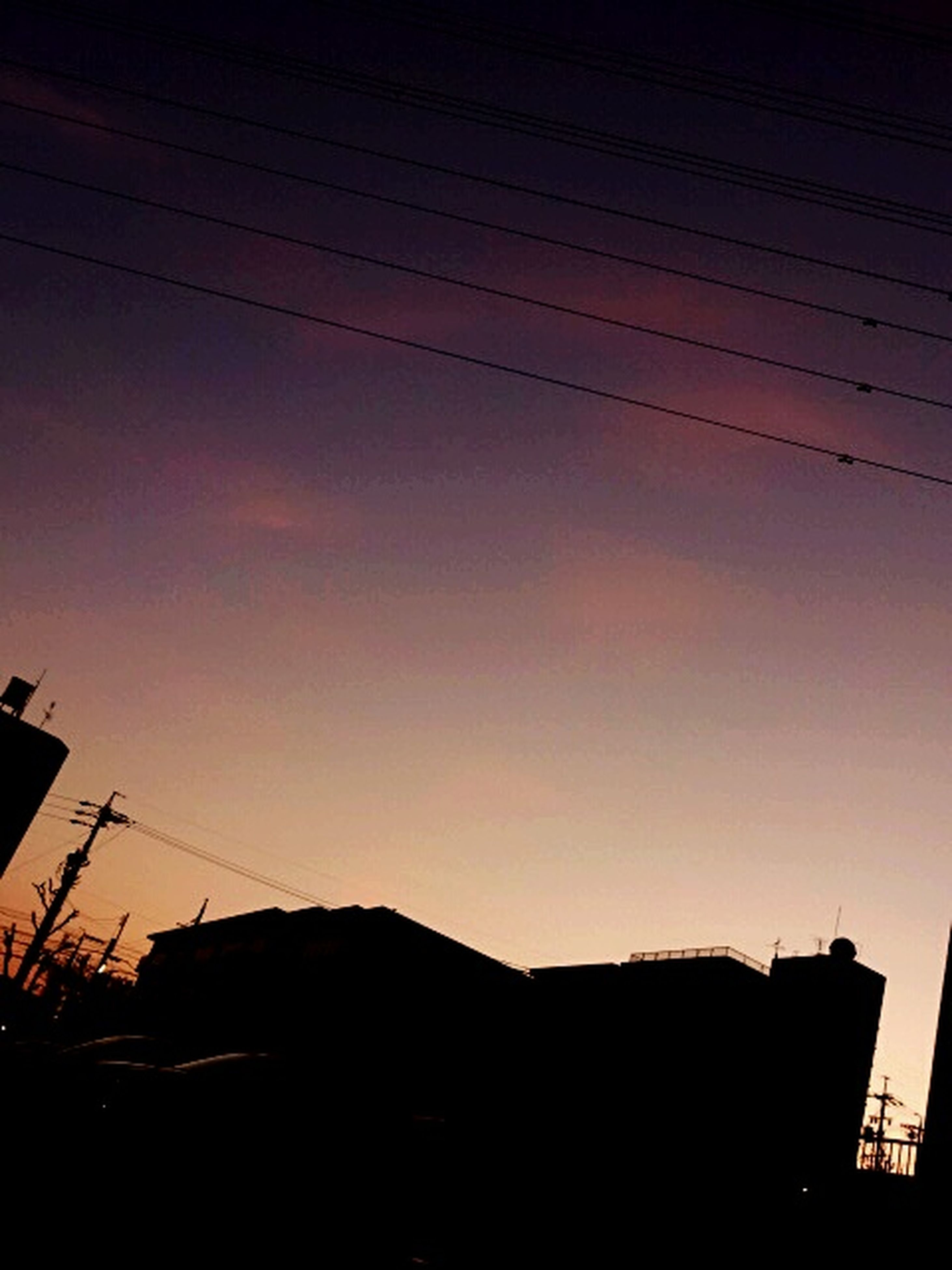 silhouette, sunset, low angle view, power line, built structure, building exterior, architecture, sky, electricity pylon, electricity, dusk, cable, house, orange color, nature, outdoors, power supply, fuel and power generation, copy space, no people