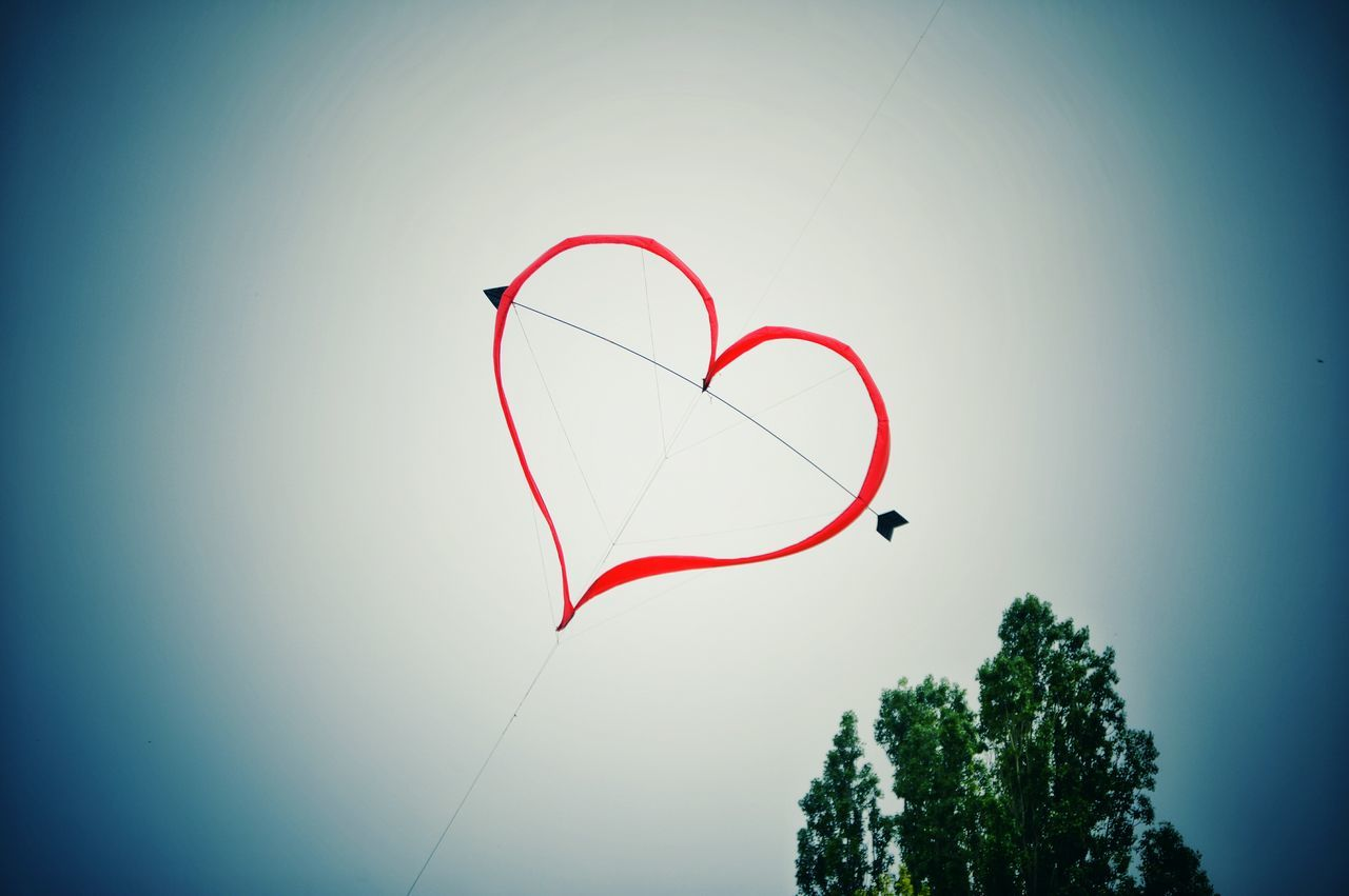Heart Shape Kite Flying In Mid Air