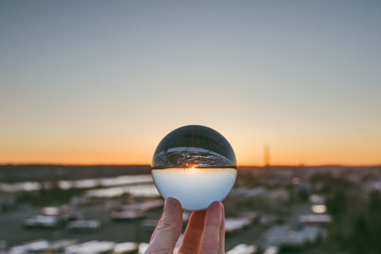 Upside down Adult Adults Only Clear Sky Close-up Crystal Ball Crystal Ball Day Glass Ball Holding Human Body Part Human Hand Nature One Person Outdoors People Real People Refraction Sea Sky Sunset Upside Down Water