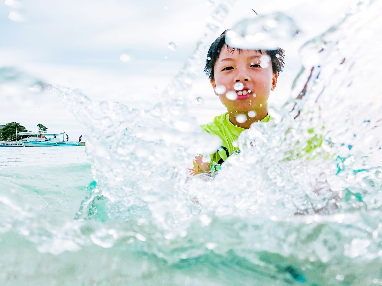 Summer fun splashing around on the beach. Childhood Child Children Only One Person Happiness Fun Swimming Pool Smiling Enjoyment One Boy Only Boy Kid Drops Playing Leisure Activity Portrait People Cheerful Outdoors Water Real People Splash Play Vacation