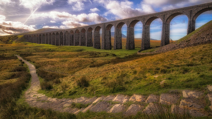 Ribblehead Viaduct, captured yesterday morning 6/10/17 EyeEm Best Shots Landscape_Collection LumixG80 Path Taking Photos Yorkshire Arch Architecture Bridge - Man Made Structure Built Structure Cloud - Sky Day Landscape Malephotographerofthemonth Mountain No People Outdoors Pretty Railway Sky Streamzoofamily Sunlight Viaduct Wide Angle Colorful