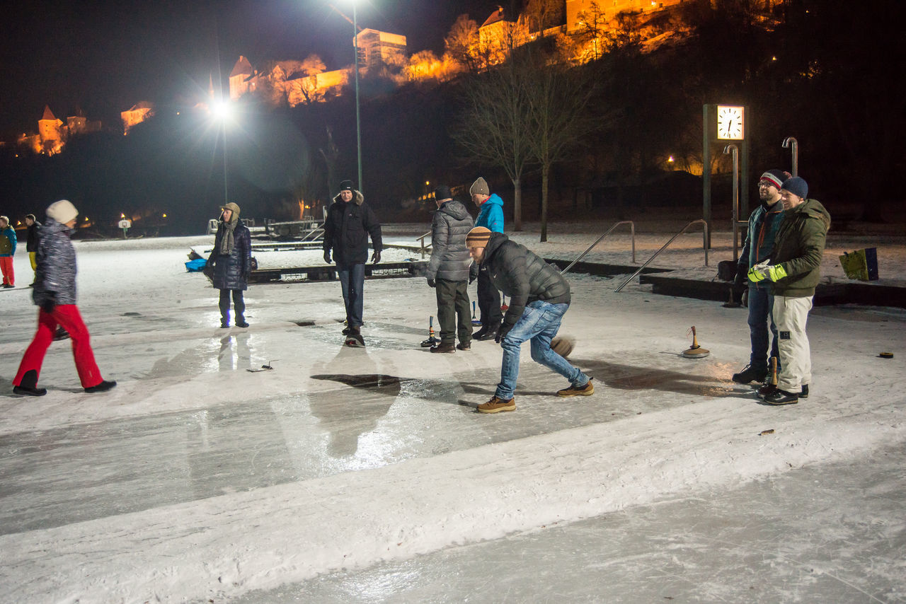 Curling Friendship Leisure Activity Lifestyles Night Outdoors People Performance Real People Teamwork