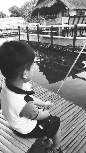 One Person Child Outdoors Water Having Fun Blackandwhite Photography Fishing Fishing Time Babybrother Babybro