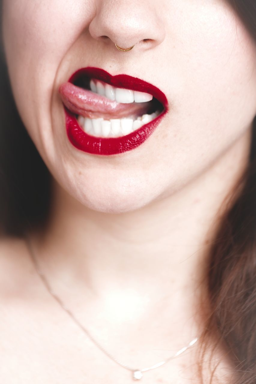 lipstick, human lips, human mouth, one person, human body part, close-up, human face, real people, mouth open, young adult, front view, young women, headshot, studio shot, red, beautiful woman, red lipstick, lip gloss, indoors, women, lifestyles, happiness, smiling, day, adult, people