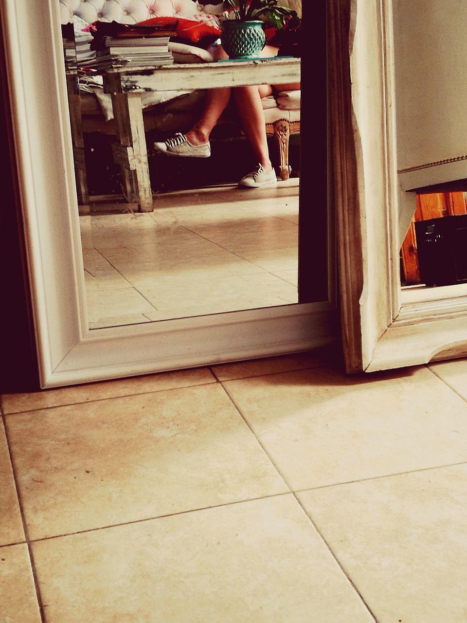 low section, one person, human leg, indoors, barefoot, door, real people, home interior, tiled floor, window, domestic life, sitting, doorway, human body part, domestic room, kitchen, day, lifestyles, open door, childhood, people