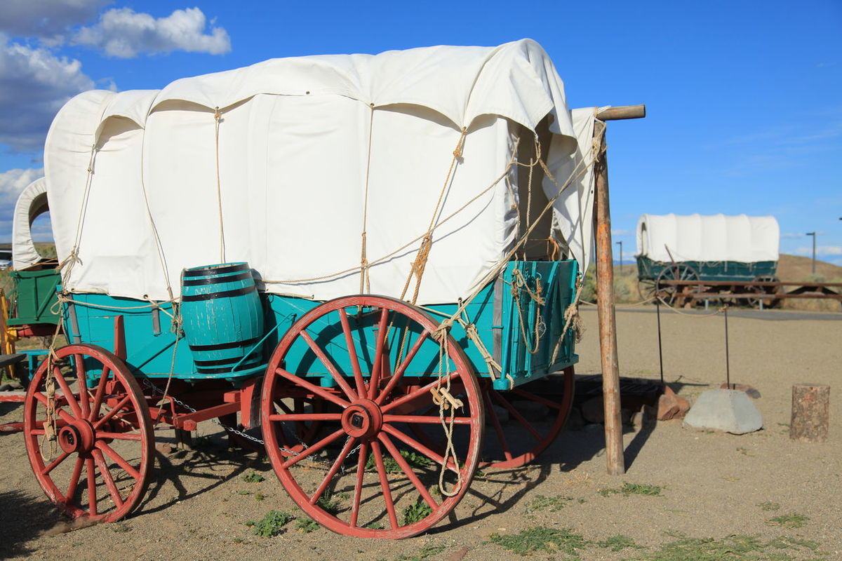 Covered Wagons at Oregon Trail Blue Cloud - Sky Conestoga College Covered Wagons Cyan Color Land Vehicle Mode Of Transport Oregon Oregon Trail Red Wheels The Past Transportation