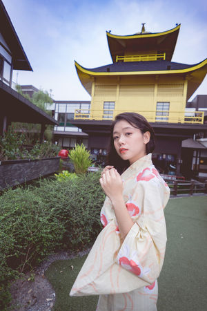 Architecture Beautiful Woman Building Exterior Built Structure City Day Front View Kimono Leisure Activity Lifestyles One Person Outdoors People Real People Sky Smiling Standing Travel Destinations Tree Young Adult Young Women