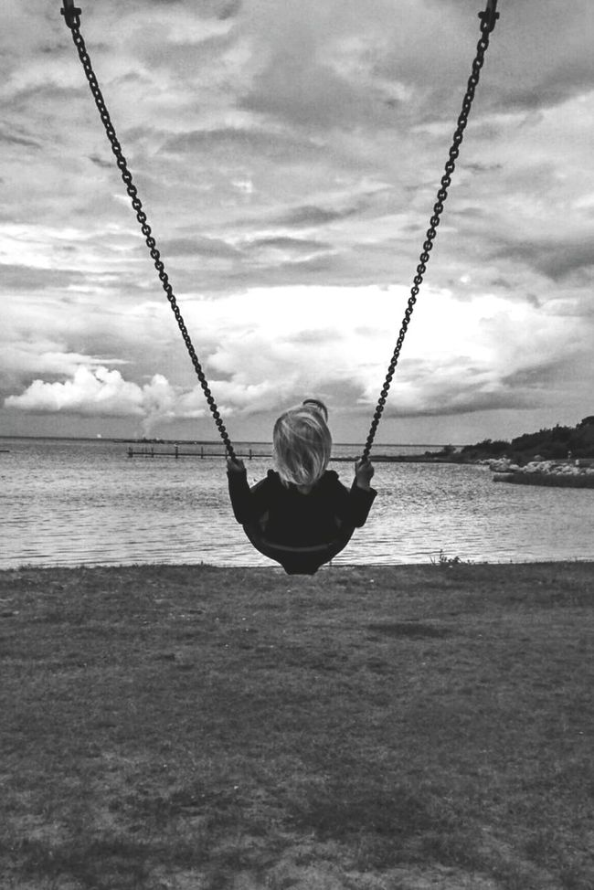 Swinging Swing Playground Sea View Sea And Sky Girl Childhood Enjoying Life Magnificent Magnifique Europe Minimalism Fine Art Black & White Eyeemphoto Black And White Blackandwhite Landscape Somewher Under The Rainbow Sky_collection Chains Enjoying The View