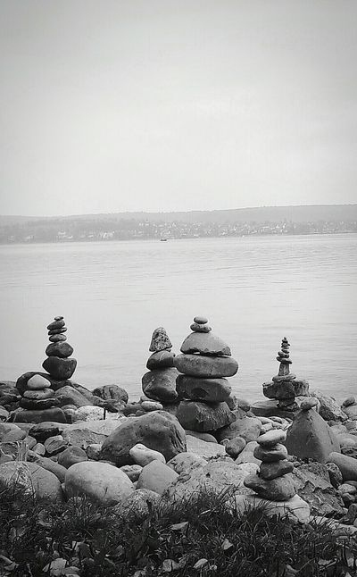 Stone Art at the shore of the Lake Of Constance , Überlingen. Cairns Stone Statue Stones Monochrome Seaside Capture The Moment Bodensee Landscapes With WhiteWall