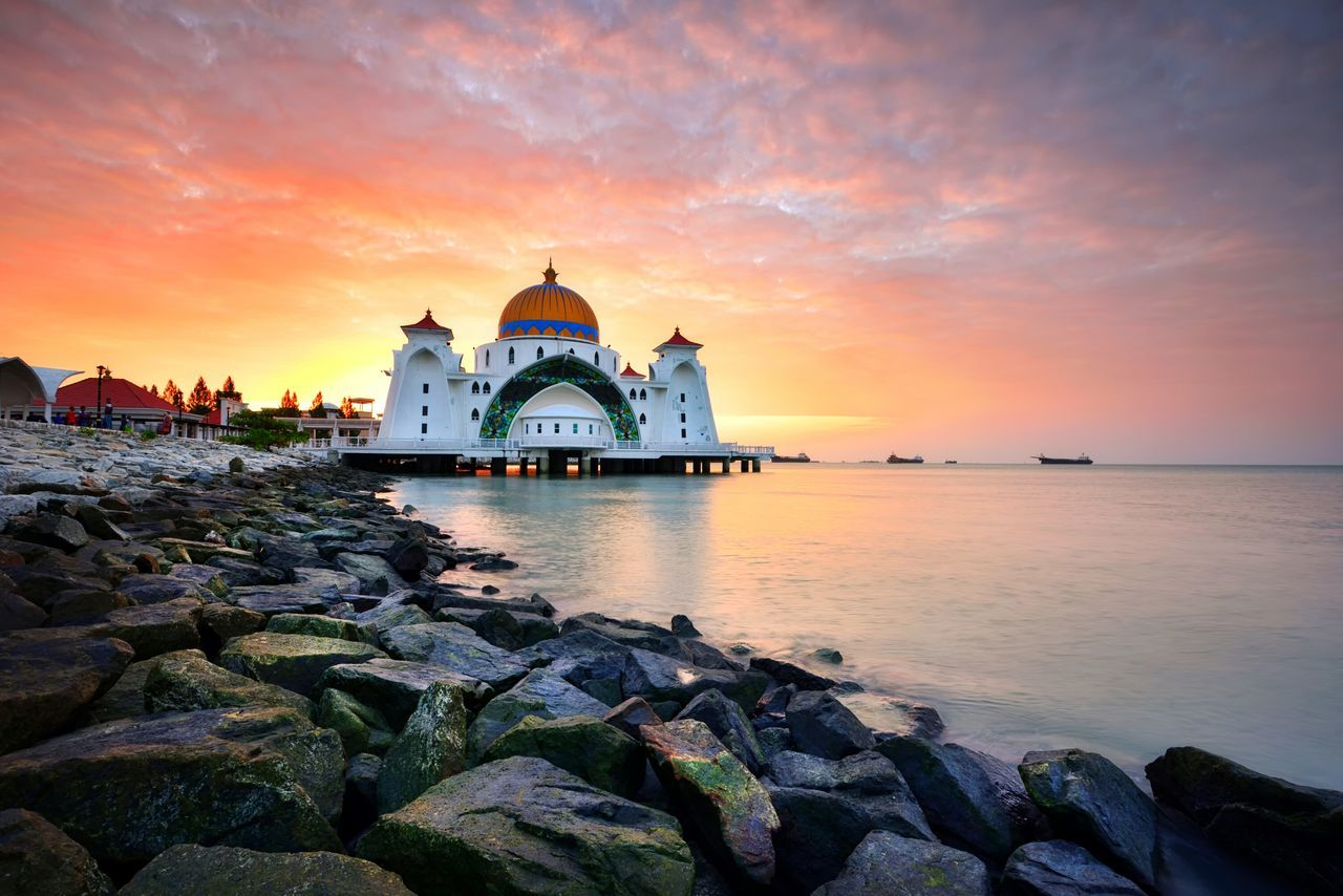 Malacca Straits Mosque Sunrise Sunset Mosque Architecture Minaret Sea Beach Scenics Tranquil Scene Nature Dramatic Sky Backgrounds Cloudscape Sky Landscape Beauty In Nature Background Travel Destinations EyeEmbestshots Getty Images EyeEmBestPics Eyeemphotography Colorful Malacca