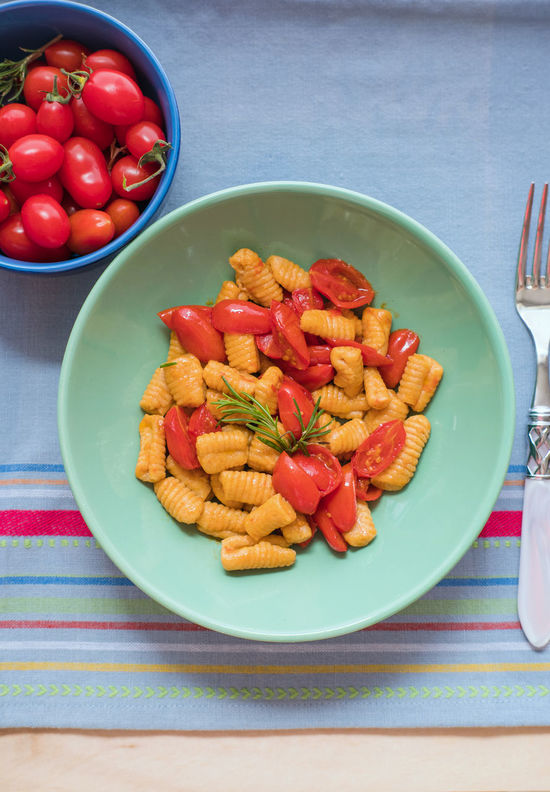 Gnocchi with tomatoes Bowl Close-up Confit Food Food And Drink Gnocchi Gnocchi Di Patate Handmade Healthy Eating High Angle View Homemade Homemade Food Indoors  No People Plate Ready-to-eat Red Table Tomatoes Food Stories