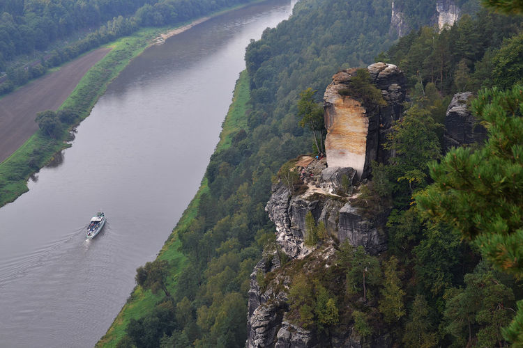 Beauty In Nature Building Exterior Cliff Climbing Paradise Distant Elbsandstein-Gebirge Famous Place Forest High Angle View Nature Outdoors River River Elbe Saxony Ship Travel Tourism Travel Destinations Water Waterfront