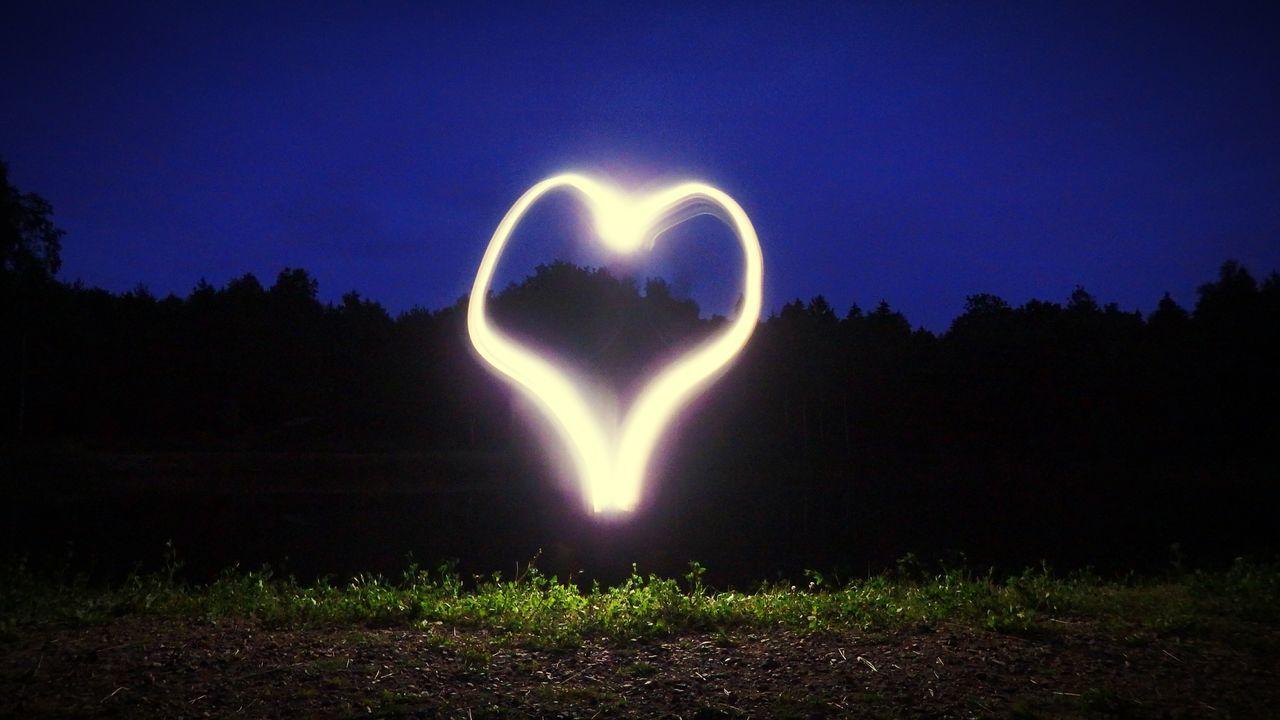 heart shape, love, night, nature, illuminated, silhouette, beauty in nature, outdoors, scenics, no people, sky, tree