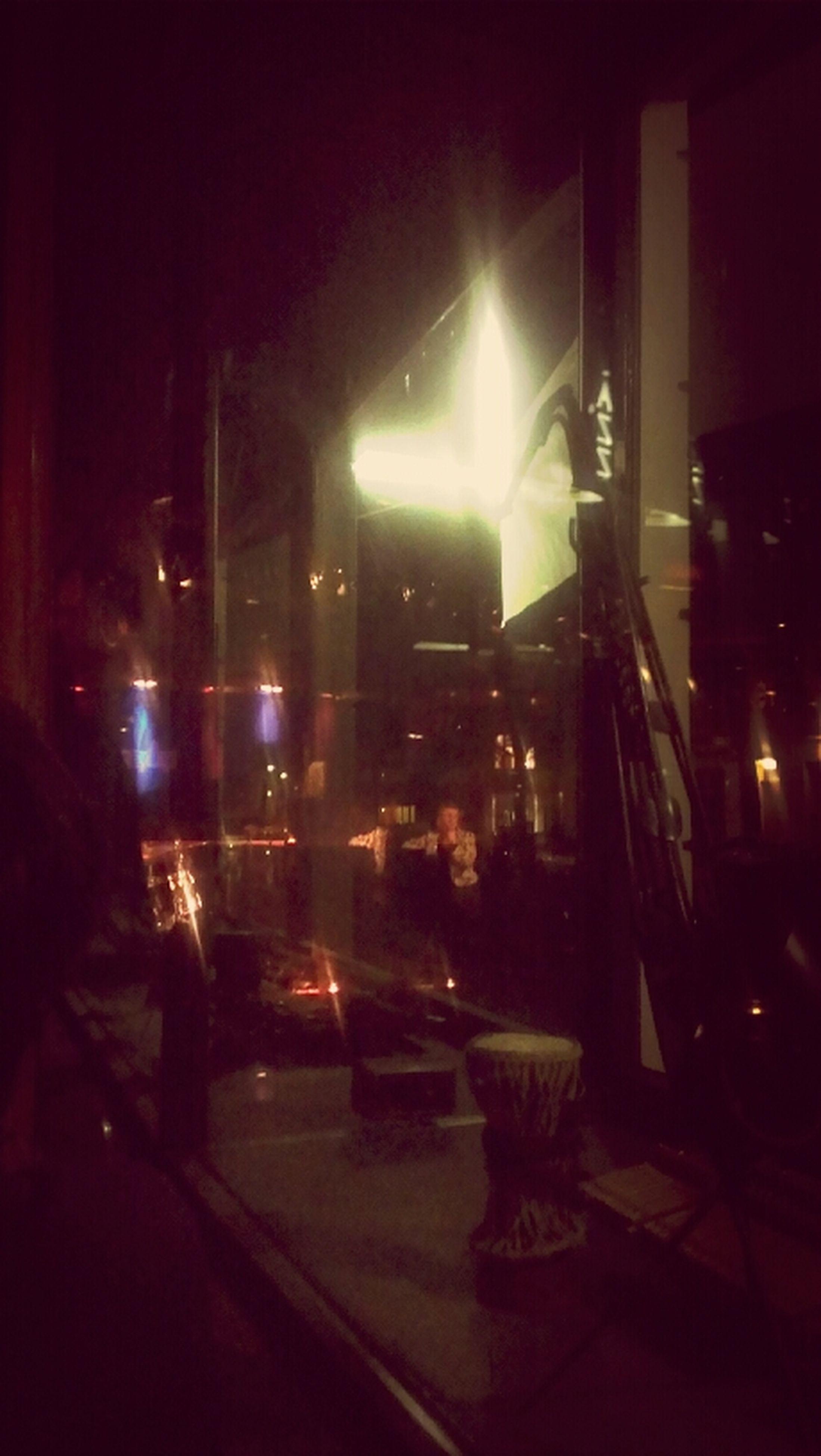 illuminated, night, building exterior, architecture, city, built structure, lighting equipment, dark, street, street light, light - natural phenomenon, city life, empty, window, incidental people, indoors, road, glass - material, no people