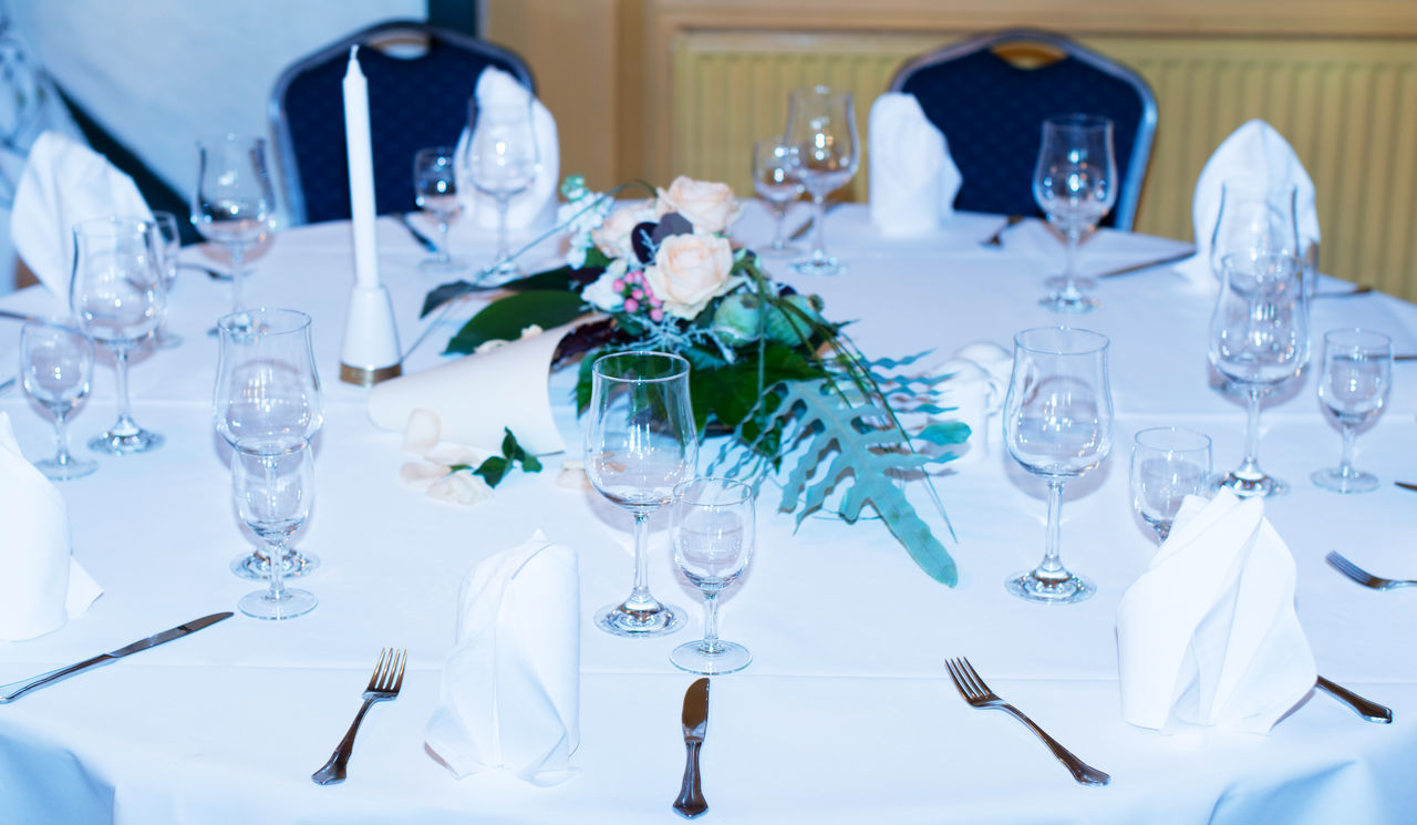 Table decoration in a restaurant for a wedding Arrangement Banquet Bouquet Candle Candle Light Catering Catering Trade Celebration Covered Table Cutlery Dishes Event Festival Board Flowers Food Glass Gourmet Hotel Marriage  Party Restaurant Solemnity Table Decoration Wedding Wedding Day