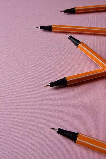 Close up color pens Art Is Everywhere Drawing Class Office Orange Pink Studio Work Working Workshop Write Writers Writing Close-up Colored Pencil Creative Creative Class Design Drawing Ingeneering Looking For Writers Pen Pencil Pink Background Table Working Surface