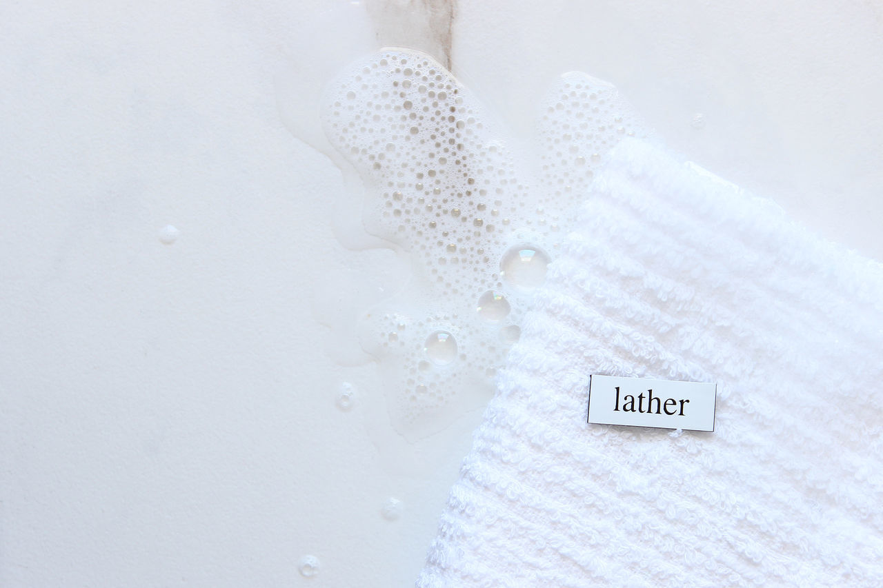 Lather up Bathroom Body Care Bubbles Clean Fresh Health And Beauty Hygiene Idiom In A Lather Lather Lathered Up Soap Spotless  Suds Text Washcloth Washing Water White