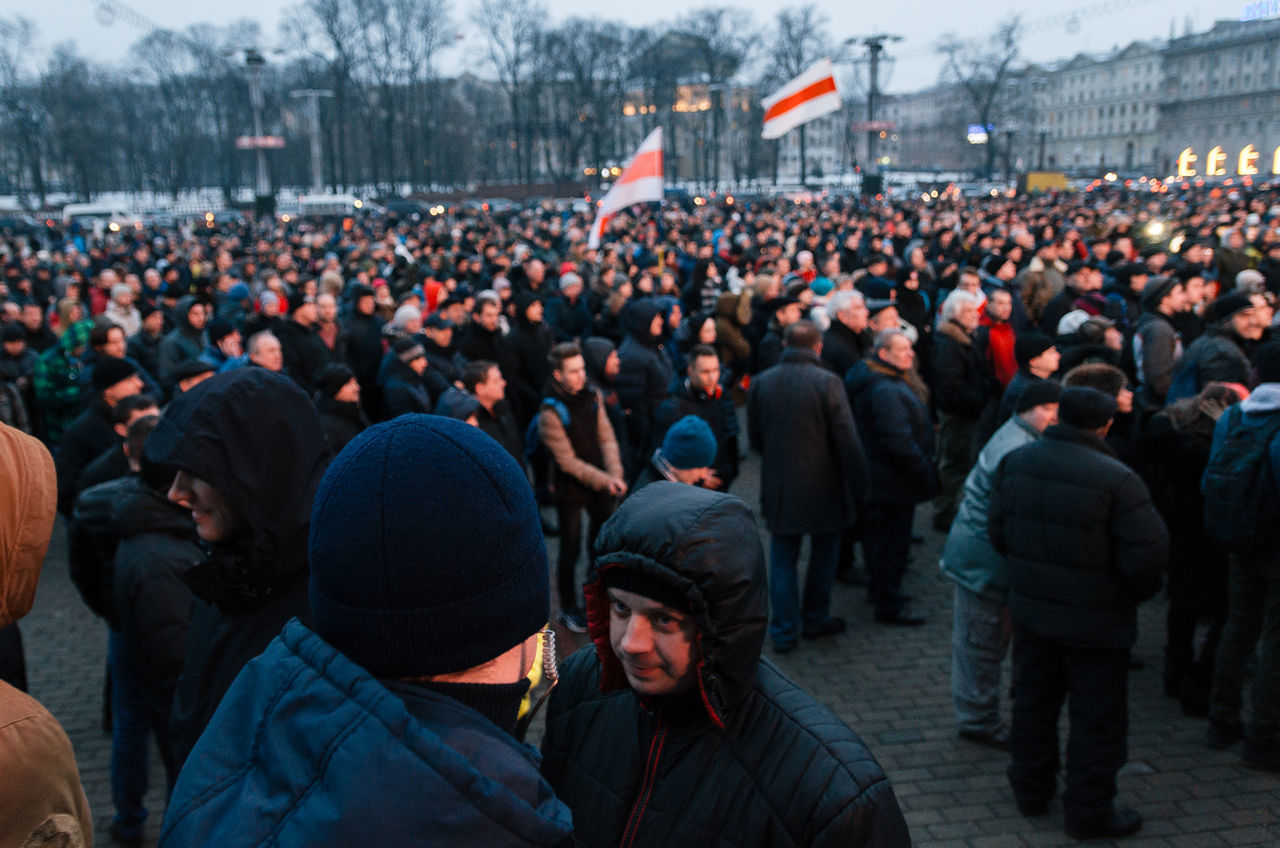 Minsk, Belarus - February 17, 2017 - Police officers in civilian clothes are among the protesters. Belarusian people participate in the protest against the decree 3 'On prevention of social parasitism' of President Lukashenko in the center of Minsk Adult Belarus Casual Clothes Casual Clothing Crowd Group Of People Headphone Large Group Of People Outdoors People Police Policeman Protest Protesters Watching