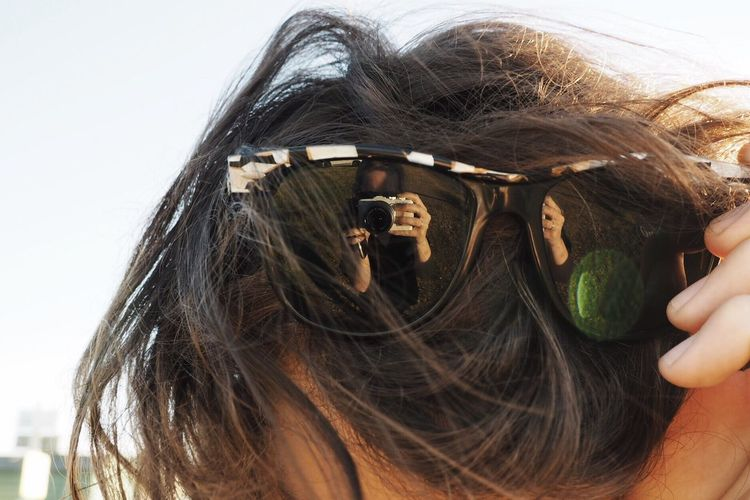 Summer in the reflection Reflection Reflection_collection Sunglasses Summer Views Sunglasses In Hair Dark Hair Girl Reflection Light Apperture Young Women Long Hair Headshot Person White Background Young Adult