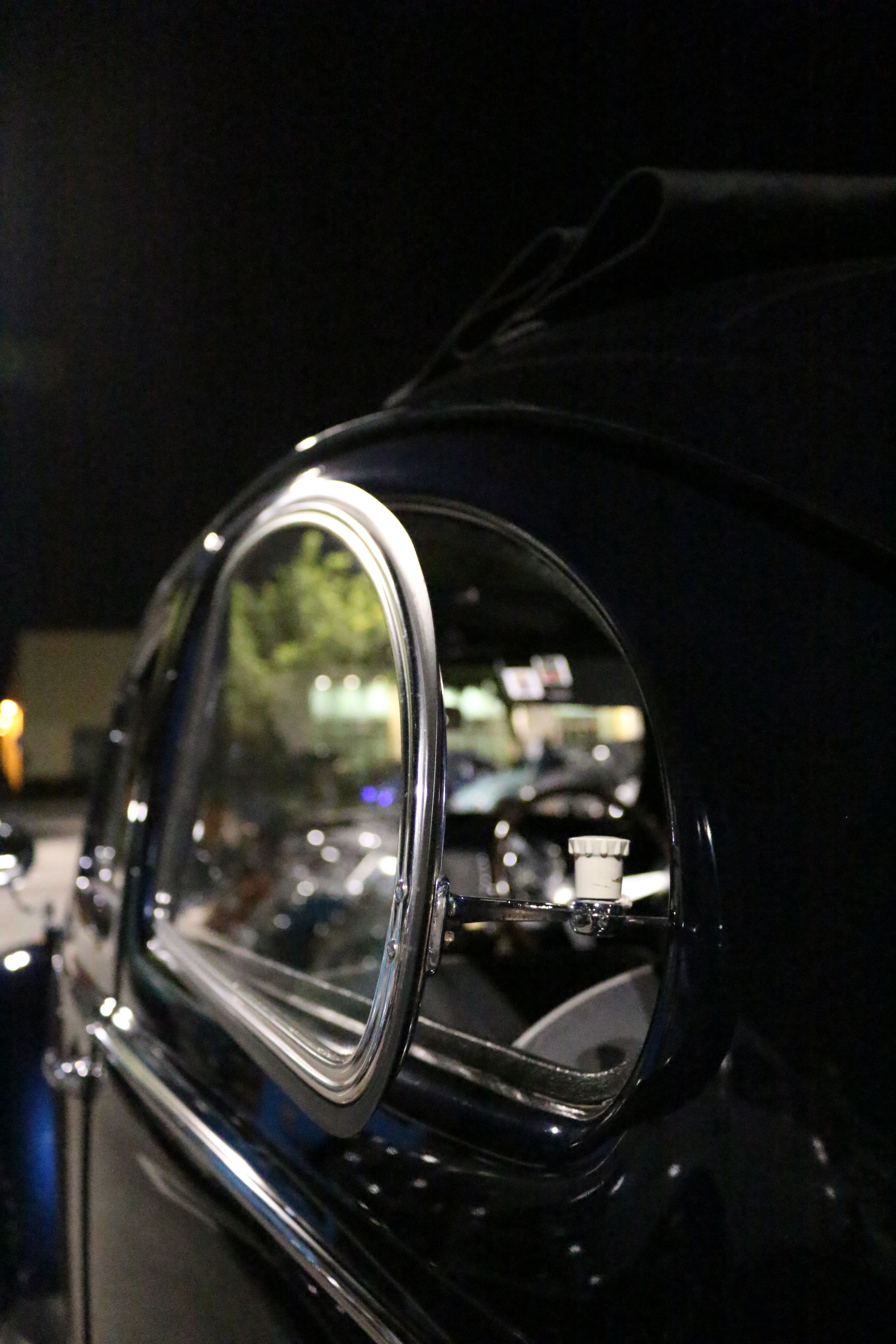 close-up, indoors, reflection, glass - material, metal, focus on foreground, transparent, shiny, part of, old-fashioned, technology, no people, selective focus, single object, retro styled, still life, lighting equipment, detail, car, cropped