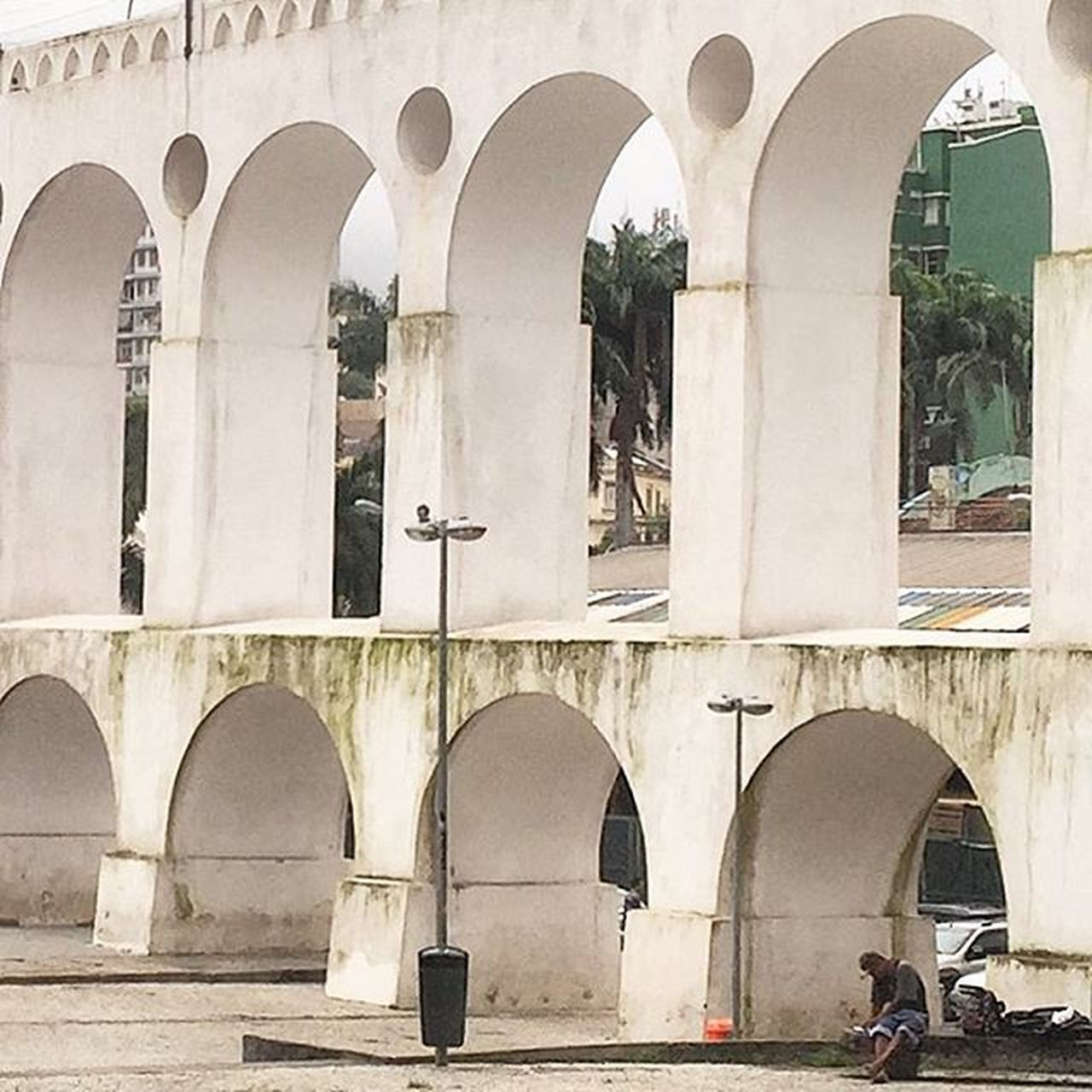 arch, architecture, built structure, architectural column, day, building exterior, outdoors, window, bridge - man made structure, real people, city