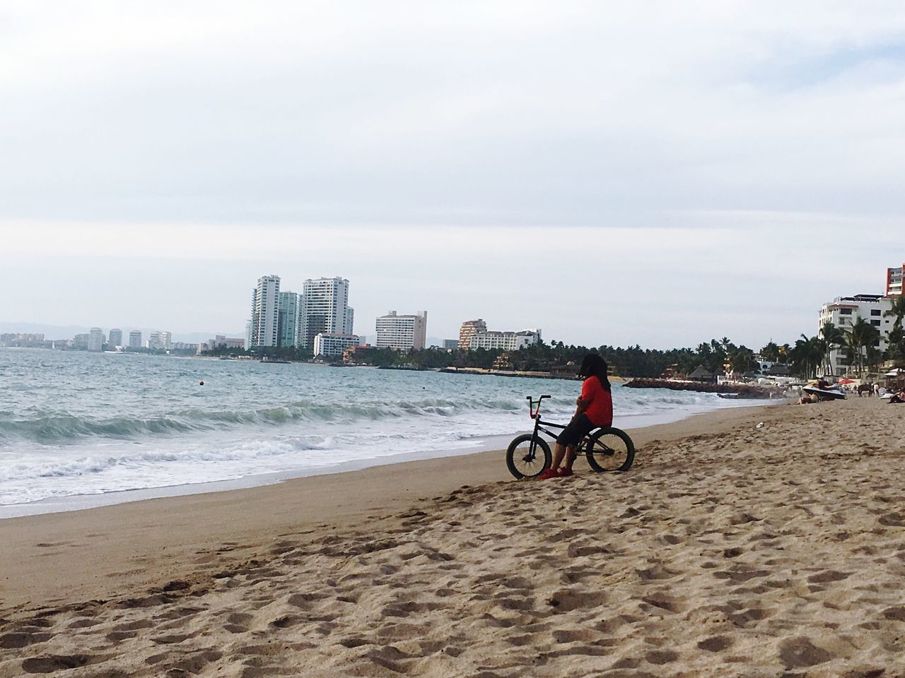 Disfrutando De La Vida Sea Beach Water City Shore Sky Men Building Exterior Built Structure Day One Person Cityscape Bicycle Reflection Live For The Story