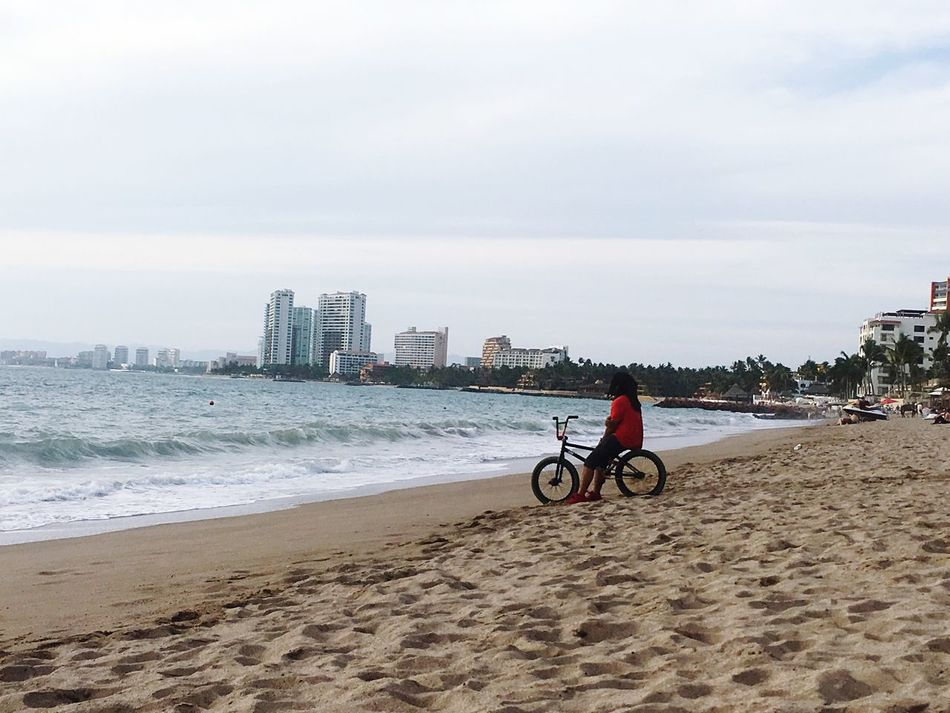 Disfrutando De La Vida Sea Beach Water City Shore Sky Men Building Exterior Built Structure Day One Person Cityscape Bicycle Reflection