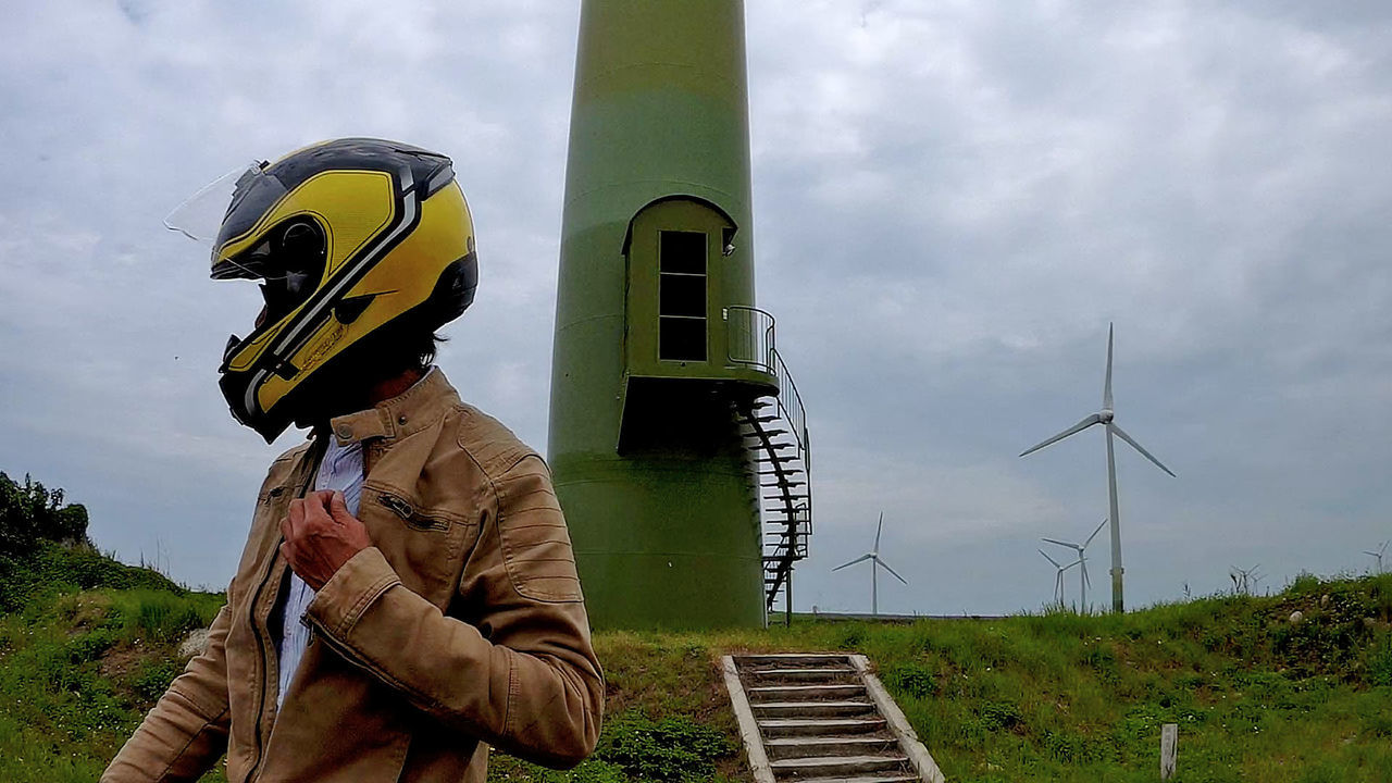Alternative Energy Built Structure Day Environmental Conservation Field Fuel And Power Generation Helmet Industrial Windmill Leisure Activity Lifestyles Men Nature One Person Outdoors People Real People Renewable Energy Sky Standing Technology Wind Power Wind Turbine Windmill