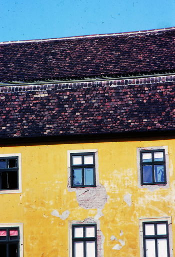 1977 Architecture Austria Building Exterior Built Structure Day Deterioration House Innsbruck No People Outdoors Roof Tiles Windows Yellow