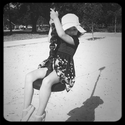 Swinging at Lake Macquarie Variety Playground by Owoteva