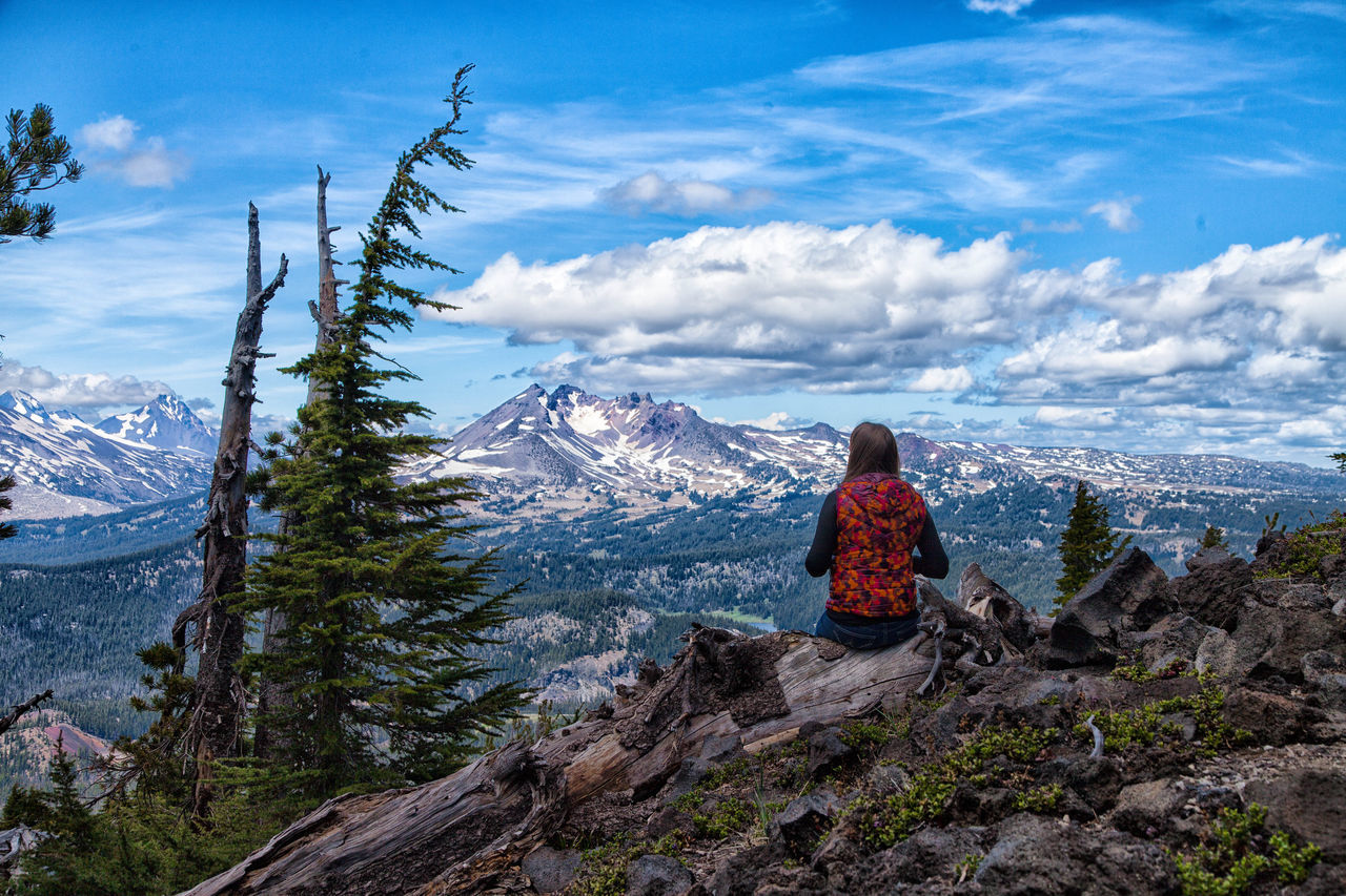 Adventure Beauty In Nature Cloud - Sky Hiking Landscape Leisure Activity Lifestyles Looking At View Mountain Mountain Peak Mountain Range Nature One Person One Woman Only Only Women Outdoors People Rear View Scenics Sky Tourism Travel Travel Destinations Vacations Women