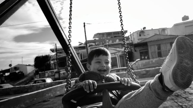 The Portraitist - 2016 EyeEm Awards Little Boy My Son Having Fun Swinging Loughing From My Point Of View Life In Motion Playground Childsplay Childhood Blackandwhite Photography Kids Being Kids Children Photography Black And White Low Angle View The Human Condition Black&white Childrenphoto Black & White Found On The Roll Malephotographerofthemonth