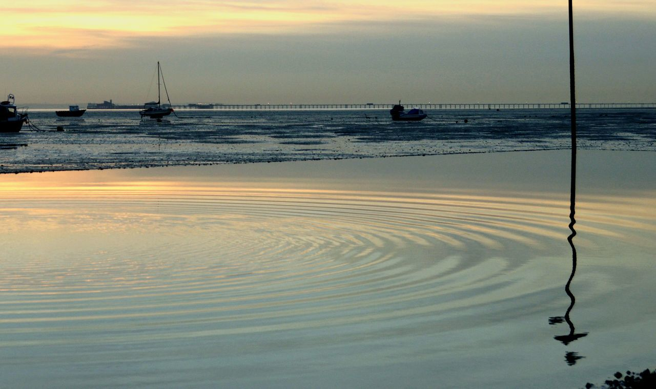 Water Reflection Rippled Sky Sea Horizon Over Water Beauty In Nature Outdoors Beach Sunset Nautical Vessel No People Southend On Sea