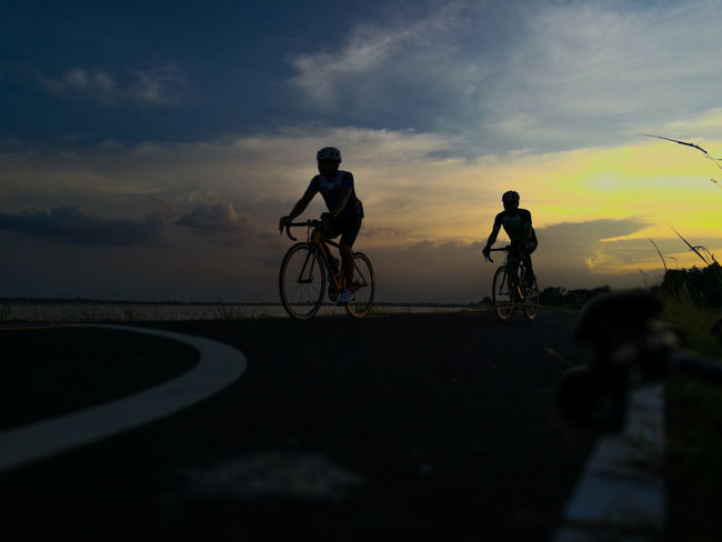 RhinoSurinCyclingClub Rhinosurin Surin ThailandSurin Cycling Road Sky And Clouds Sports Sports Photography Sunset Bicycle Travel Dusk Cycling Only Men Two People Outdoors Silhouette Healthy Lifestyle Person Sky Vacations Men Dramatic Sky People